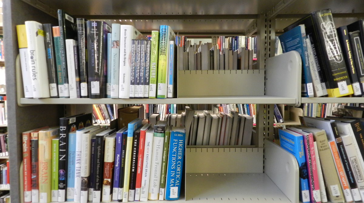 Picture of a library bookshelf that has been shifted so there is space to add more books in the future